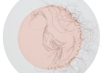 "Ancestry of Anger detail of Betty Freidan, 2016, hand-sewn human hair on fabric, each 8"" diameter"